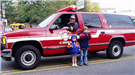 Kids Outside Fire Vehicle
